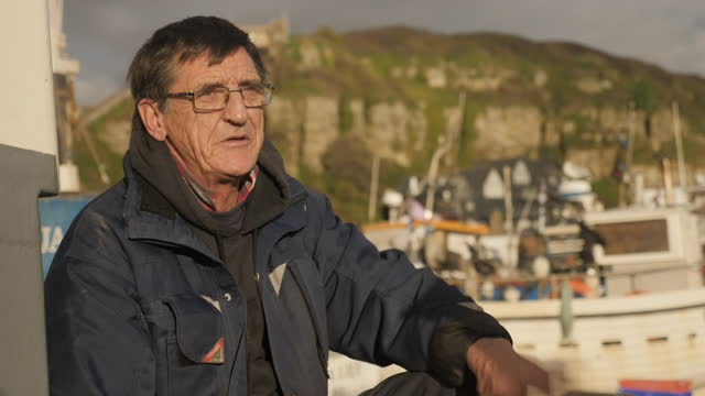 shows exterior shots fishermen and fishing industry on the south coast of england in hastings, east sussex, england, and interviews with people... - fishing stock videos & royalty-free footage