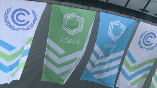 shows exterior shots flags and logos for cop 24 flying from conference building sir david attenborough has painted a bleak picture of our planet's... - 2015 stock videos & royalty-free footage