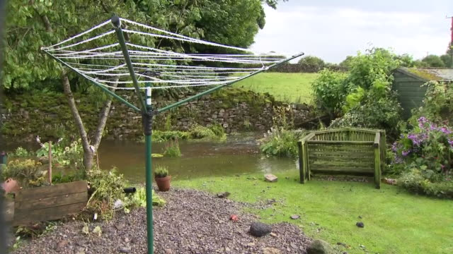 Shows exterior shots flood water filling the end of garden after flash floods ripped through the village of Bellerby in the Yorkshire Dales For parts...