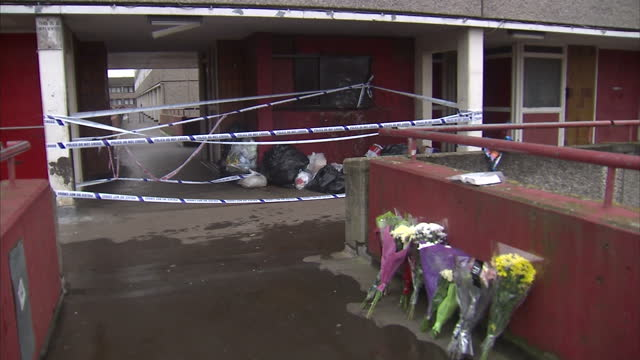 Shows exterior shots flowers left in tribute to murder victim near the site of his death on the Aylesbury Estate A teenager killed in a row over a...