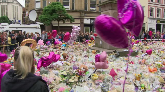 Shows exterior shots flowers messages and balloons left in tribute to the victims of the Manchester Terror Attack filling St Anne's Square on 29th...