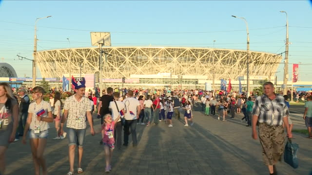 shows exterior shots football fans arriving outsidevolgograd arena stadium 2018 world cup flags and signs ahead of the 2018 world cup opening round... - world championship stock videos & royalty-free footage
