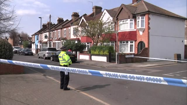 shows exterior shots forensics officers and police officers at crime scenes investigating a series of stabbings in edmonton london aerial shots crime... - stechen stock-videos und b-roll-filmmaterial