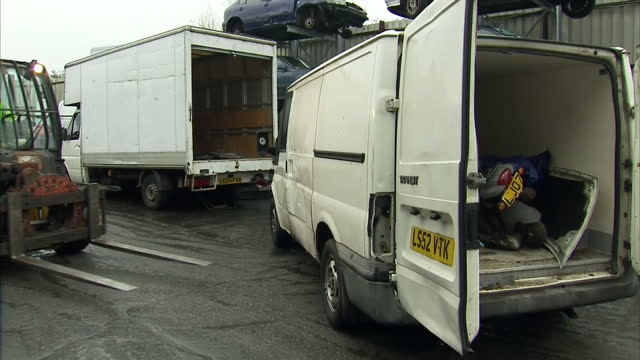 vídeos de stock, filmes e b-roll de shows exterior shots fork lift truck picking up condemned white transit van and moving it away to be scrapped at scrapyard on december 10 2016 in... - moving activity