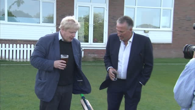 shows exterior shots former england cricketer ian botham and conservative mp and 'out' campaigner boris johnson walking out building and standing on... - 2016 european union referendum stock videos and b-roll footage