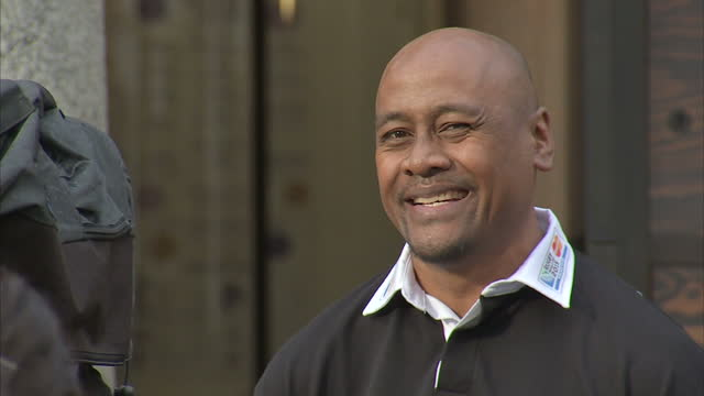 shows exterior shots former new zealand rugby player jonah lomu smiling at end of interview and walking through covent garden in london. rugby star... - 2015 stock videos & royalty-free footage