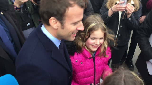 Shows exterior shots French Presidential Candidate Emmanuel Macron taking selfie with a young fan on 21st February 2017 in Lodnon England