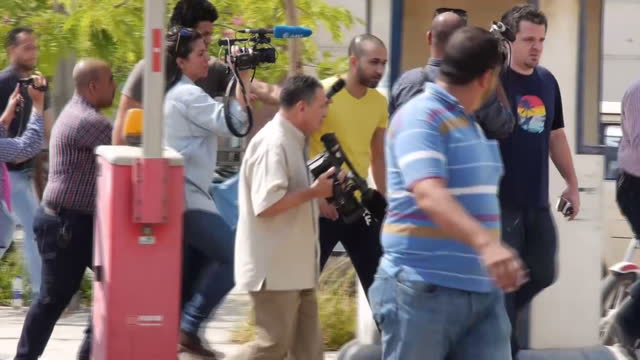 Shows exterior shots friends and relatives of passengers on EgyptAir Flight MS804 arriving at Cairo Airport and press filming them Egyptian officials...
