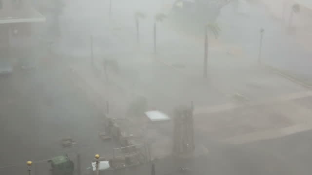 Shows exterior shots from hotel window strong winds as Hurricane Maria arrives in San Juan with rain being pushed by wind waves throwing water across...