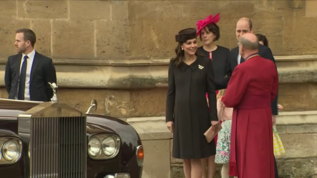 shows exterior shots girls arriving outside st george's chapel in windsor castle to present flowers to the royals attending the easter service... - st. george's chapel stock videos and b-roll footage