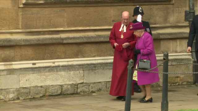 shows exterior shots girls waiting outside st george's chapel in windsor castle to present flowers to queen elizabeth ii as she departs after the... - st. george's chapel stock videos and b-roll footage