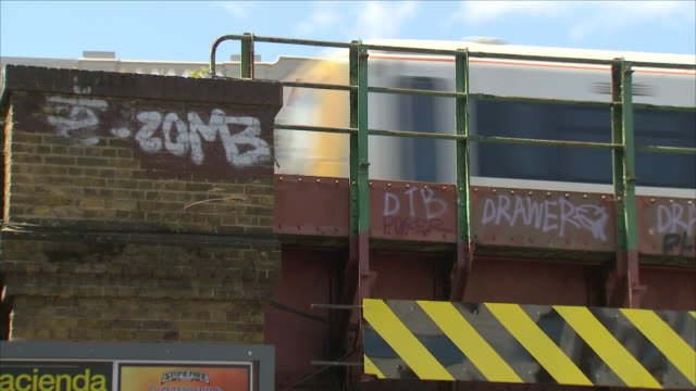 shows exterior shots graffiti on walls and railway bridges near loughborough junction station in south london. british transport police officers were... - railway junction stock videos & royalty-free footage