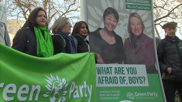 Shows exterior shots Green Party demonstrators on College Green holding signs asking for more women MPs an invite to the TV debate on January 19 2015...