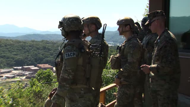 shows exterior shots group of us soldiers on high lookout point watching exercises and communicating via radio headset during training exercise it's... - south korea stock videos & royalty-free footage