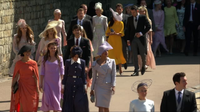 shows exterior shots guests arriving at st george's chapel for the wedding of prince harry, duke of sussex, and meghan markle on the 19th may 2018,... - guest stock videos & royalty-free footage