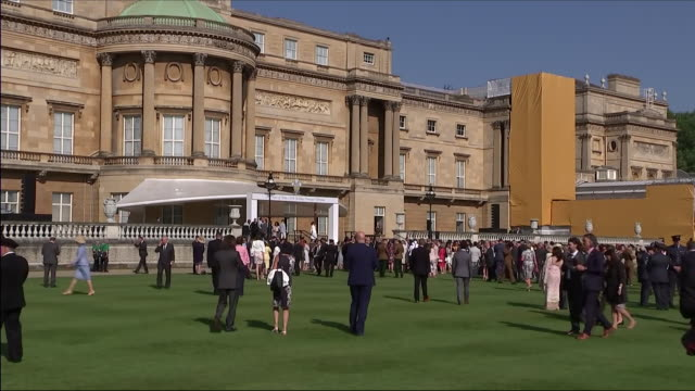 shows exterior shots guests enjoying themselves on the lawns at an official buckingham palace summer garden party to celebrate prince charles' 70th... - garden party stock videos & royalty-free footage