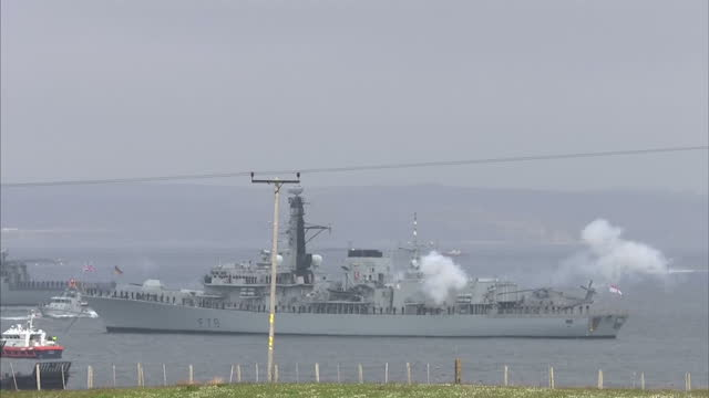 shows exterior shots guns mounted on deck of hms kent moored in scapa flow with british navy sailors firing gun salute before service of remembrance... - hoy stock videos & royalty-free footage