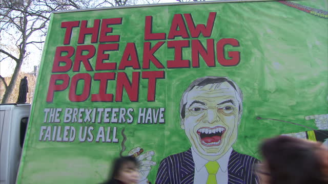 shows exterior shots hand painted poster with sign reading the law breaking point the brexiteers have failed us all on side of vehicle exterior shots... - poster stock videos & royalty-free footage