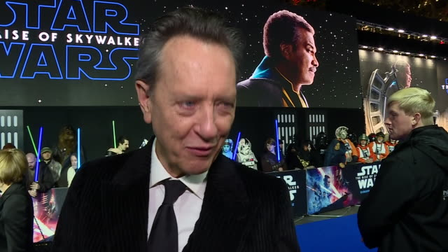 "shows exterior shots interview with actor richard e grant on the red carpet as attends the ""star wars: the rise of skywalker"" european premiere at... - richard e. grant stock videos & royalty-free footage"