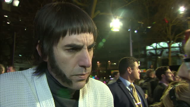 vídeos de stock, filmes e b-roll de shows exterior shots interview with actor sacha baron cohen in character as 'nobby' on grimsby town controversy and film quote the sad thing is we've... - sacha baron cohen