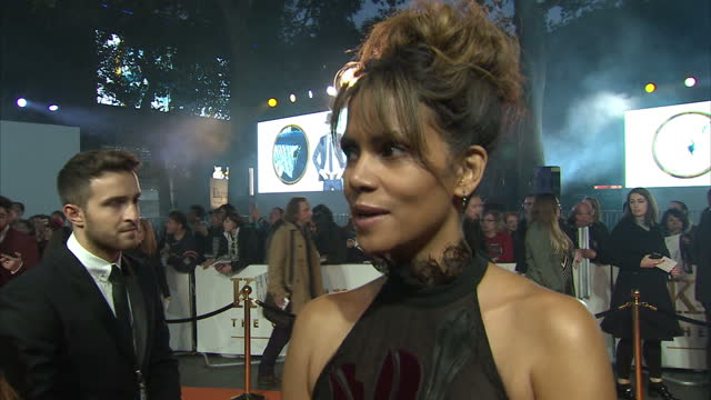clean shows exterior shots interview with actress halle berry speakig on making the film on the orange carpet at the world premiere of 'kingsman the... - 2017 stock-videos und b-roll-filmmaterial