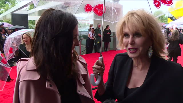 shows exterior shots interview with actress joanna lumley speaking on rain on the red carpet the best of television is honoured at the virgin tv... - british academy television awards stock videos & royalty-free footage