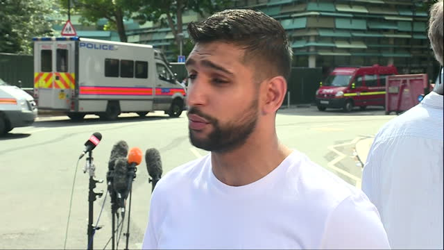 shows exterior shots interview with boxer amir khan speaking on helping victims of the grenfell tower fire and plans to raise money for them from a... - co ordination stock videos & royalty-free footage