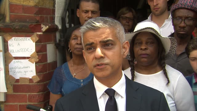 shows exterior shots interview with london mayor sadiq khan speaking on criticism of political response to grenfell tower disaster. locals and... - co ordination stock videos & royalty-free footage