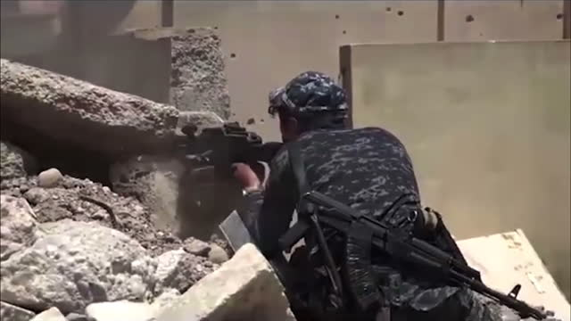shows exterior shots iraqi soldiers sheltering behind piles of rubble and round corners of building firing towards isis fighters as they fight street... - iraq stock videos & royalty-free footage
