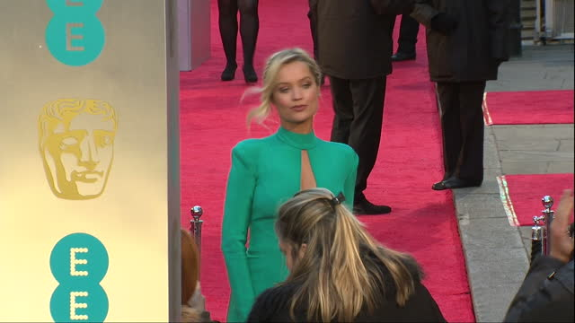 shows exterior shots irish television and radio presenter laura whitmore posing for photos on red carpet. the 2016 baftas film awards ceremony at was... - irish film and television awards stock videos & royalty-free footage