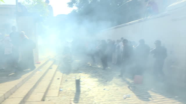 Shows exterior shots Israeli security services firing smoke grenades amongst Muslim worshippers on Temple Mount near the alAqsa Mosque compound At...