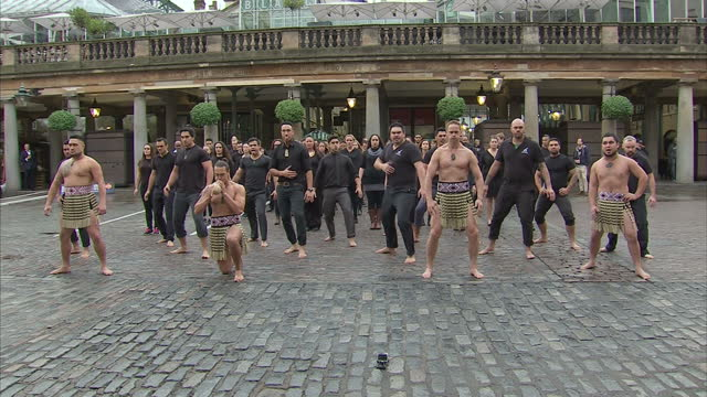 Shows Exterior shots Jonah Lomu performing a Ka Mate haka led by the Ngati Ranana London Maori Club in Covent Garden London ahead of 2015 Rugby World...