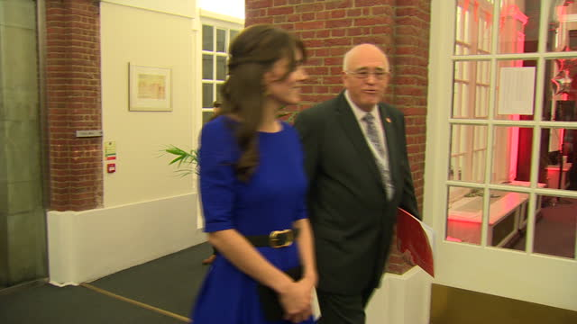 shows exterior shots kate catherine duchess of cambridge being greeted by cheif executive of the fostering network kevin williams and pausing outside... - foster care stock videos & royalty-free footage