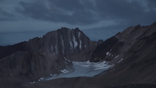 shows exterior shots landscape near ny alesund on spitsbergen in svalbard, clouds moving in front of moon above mountain. the un's intergovernmental... - dramatic landscape stock videos & royalty-free footage