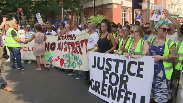 shows exterior shots large crowd of people marching in silence protest to let authorities know response to grenfell tower fire has been inadequate,... - marching stock videos & royalty-free footage