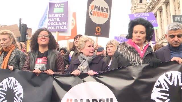 shows exterior shots large crowds marching through central london in support of march4women for international women's day and watching performances... - 国際女性デー点の映像素材/bロール