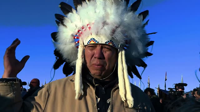 shows exterior shots large group of native americans gathered at standing rock in north dakota singing victory songs chanting and cheering after us... - pipeline stock videos & royalty-free footage