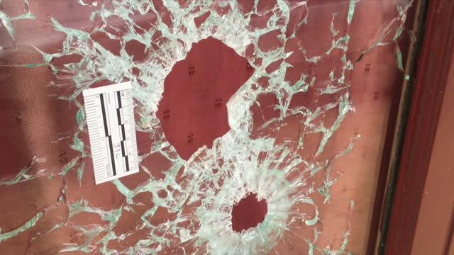 vidéos et rushes de shows exterior shots le carillon cafe in paris with people standing in street outside. exterior shots damage caused by terror attack including bullet... - bombardement