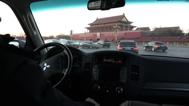 Shows exterior shots Leadership Compound and buildings in Tiananmen Square in Beijing and people standing guard filmed through car window Exterior...