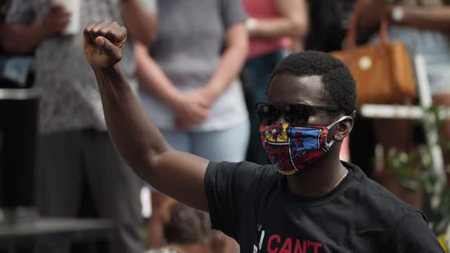 shows exterior shots man raised fist at black live matter protest in tribute to george floyd on 4 june, 2020 in minneapolis, minnesota, united states. - minnesota stock videos & royalty-free footage