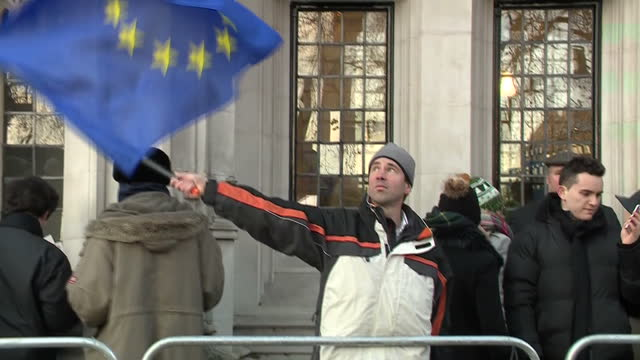 Shows exterior shots man waving an EU flag outside the UK Supreme Court Building The legal battle over Brexit goes to the Supreme Court The...