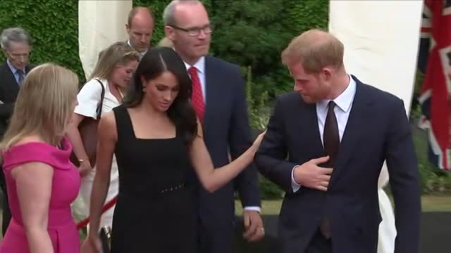 shows exterior shots meghan duchess of sussex and prince harry duke of sussex walking from stage into crowd to meet guests at a reception at... - アイルランド共和国点の映像素材/bロール