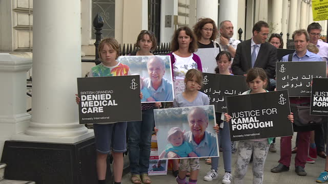 shows exterior shots members of the foroughi protesting outside the iranian embassy in london at the continuing imprisonment of their... - amnesty international stock videos & royalty-free footage