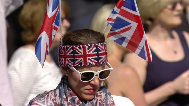 Shows exterior shots members of the public dressed in Union Jacks and wedding related outfits in Windsor for the wedding of Prince Harry Duke of...