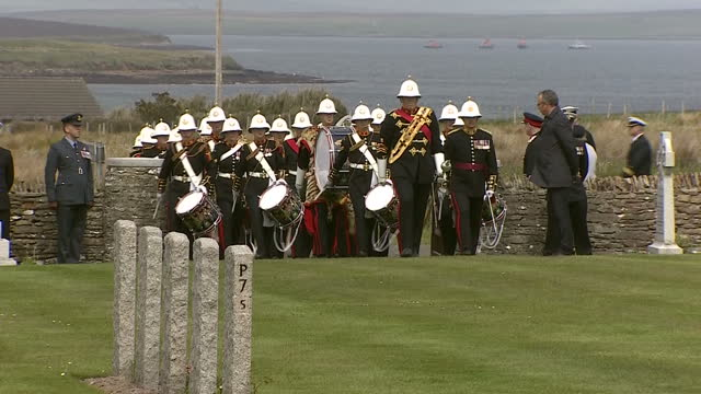 shows exterior shots military marching bands arriving at lyness world war i cemetery on hoy for battle of jutland commemoration ceremony including... - hoy stock videos & royalty-free footage