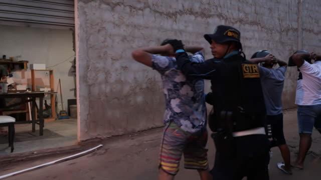 vídeos de stock e filmes b-roll de shows exterior shots military patrol driving through gang controlled favelas in city of fortaleza exterior shots armed patrols moving quickly into... - favela