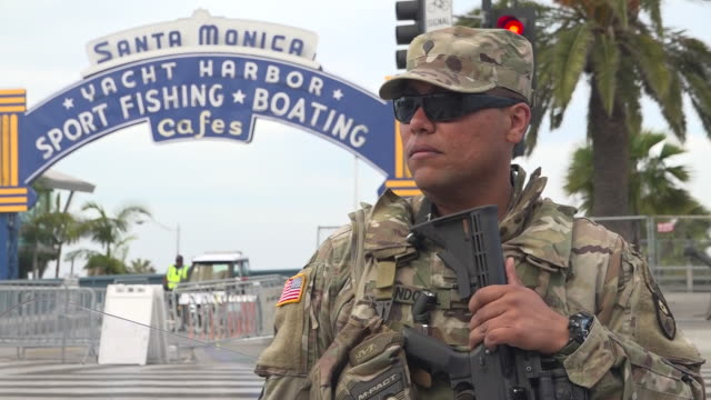 """shows exterior shots military vehicles on streets and armed national guard soldiers on patrol insanta monica, los angeles, california. """"is this who... - us militär stock-videos und b-roll-filmmaterial"""