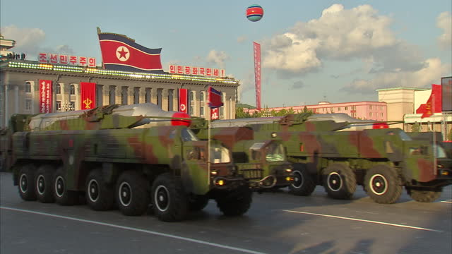 shows exterior shots missiles on military vehicles being paraded through square in pyongyang during military parade to celebrate 70 years since the... - parade stock videos & royalty-free footage