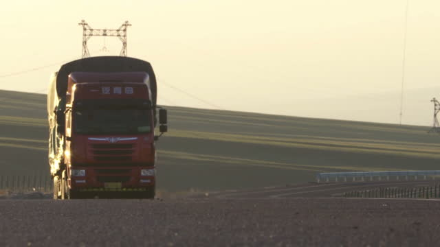 shows exterior shots mountainous and desert landscape area on the border between china and kazakhstan exterior shots lorries driving along roads... - belt stock videos & royalty-free footage