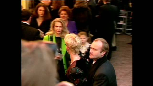 shows exterior shots musician phil collins arriving with his wife at the royal premiere for the film 'hook' on april 07 1992 in london england - hook stock videos & royalty-free footage